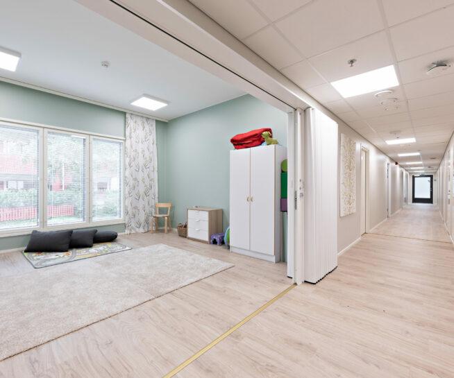 Green-walled room along the corridor.